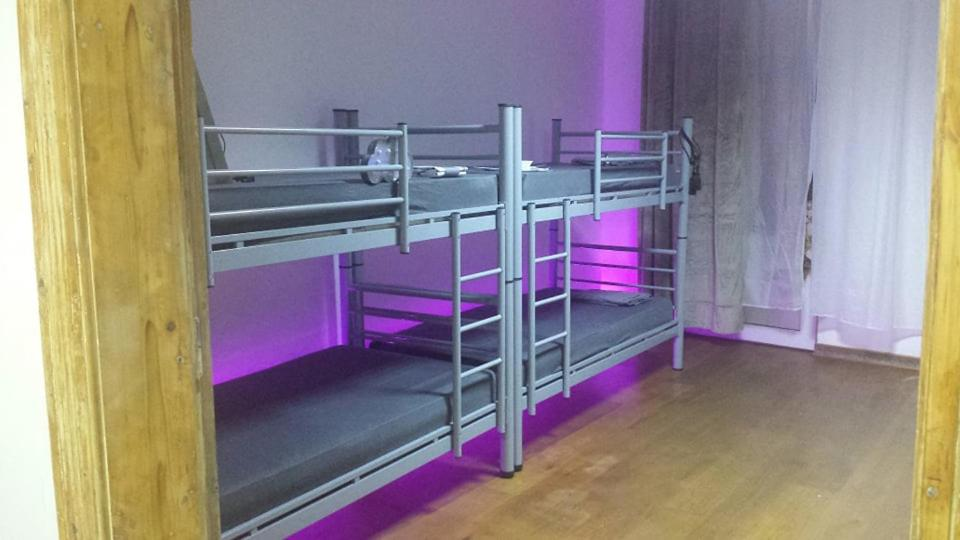 A bunk bed or bunk beds in a room at Art Hostel