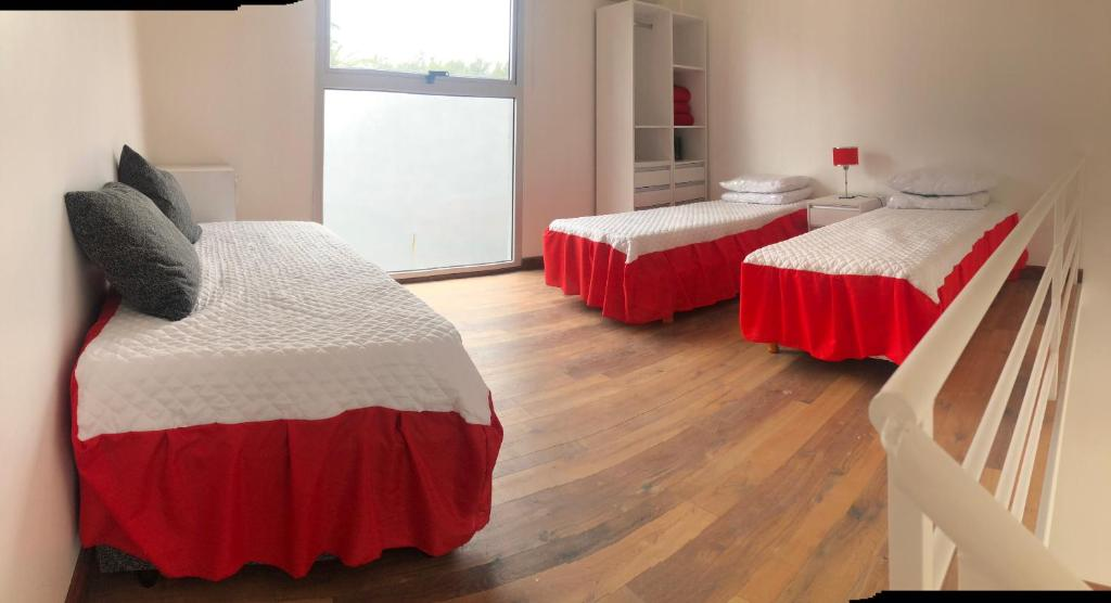 A bed or beds in a room at Lugones