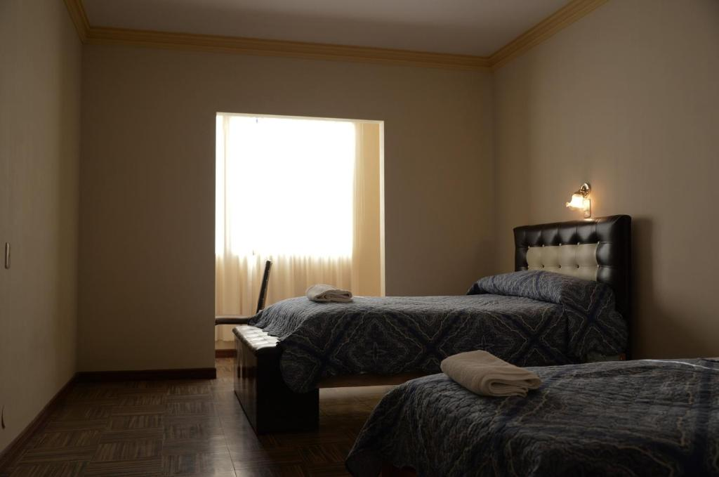 A bed or beds in a room at Garden Inn Hostel