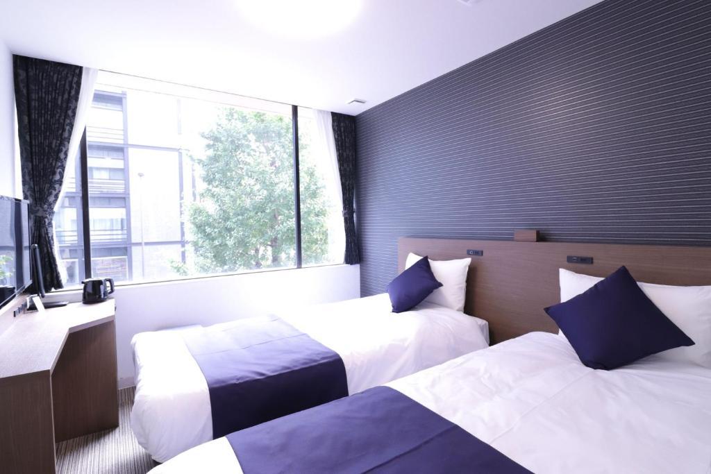 Vuode tai vuoteita majoituspaikassa Asakusa Kuramae Hotel Yume Iroha