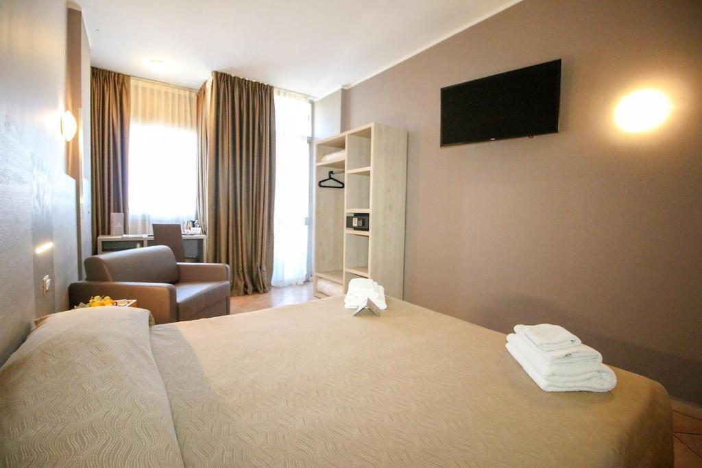Кровать или кровати в номере Hotel Miramonti