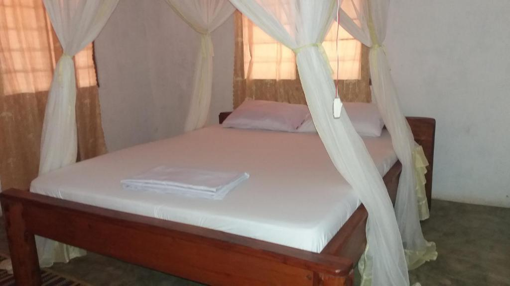 Letto o letti in una camera di Didimiza Guest House