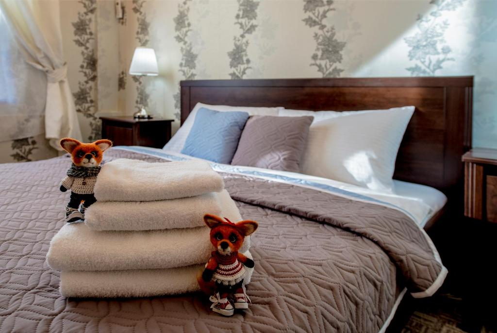 A bed or beds in a room at Sleep at Home Hotel