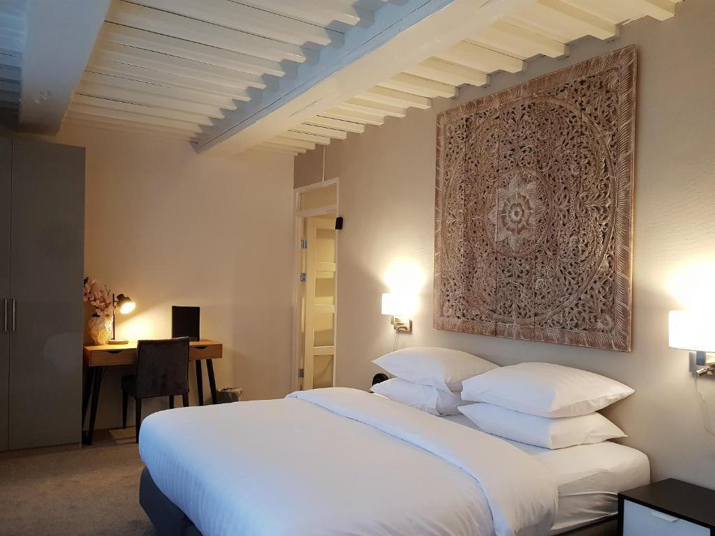 Een bed of bedden in een kamer bij Hotel Grand Canal