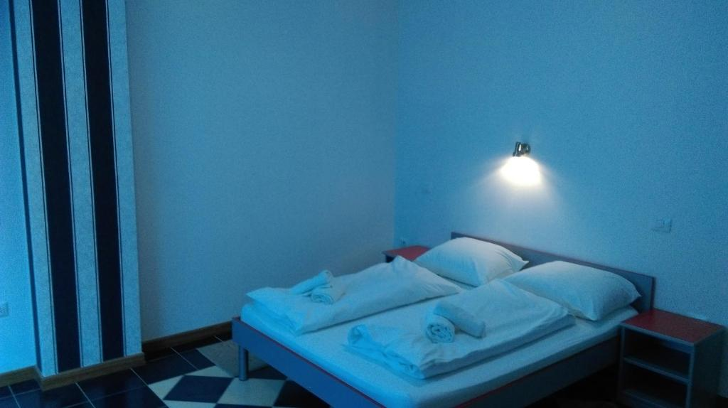 A bed or beds in a room at Hotel Stella Maris Medjugorje