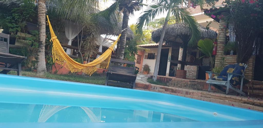 The swimming pool at or near Pousada Morena Moleca