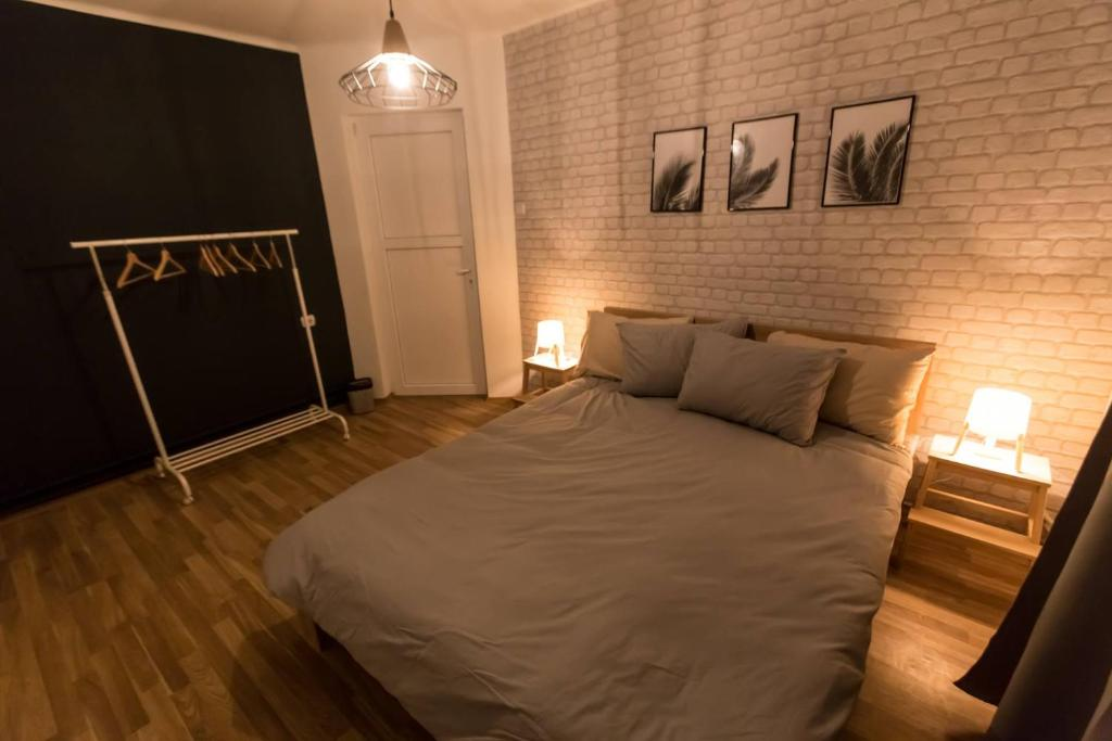 A bed or beds in a room at Clover Hostel