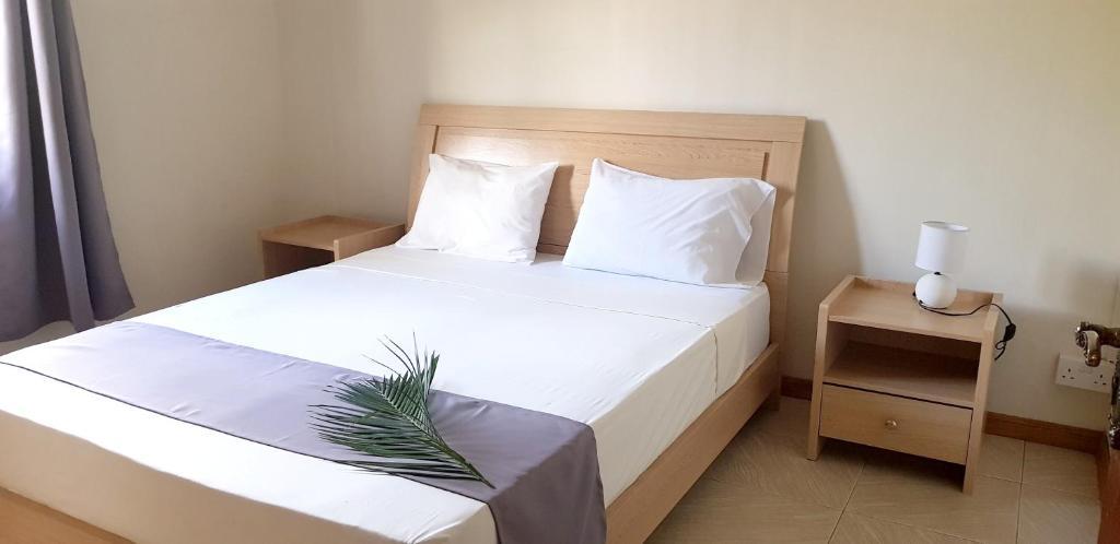 En eller flere senger på et rom på Apartment Route de la colline - 4