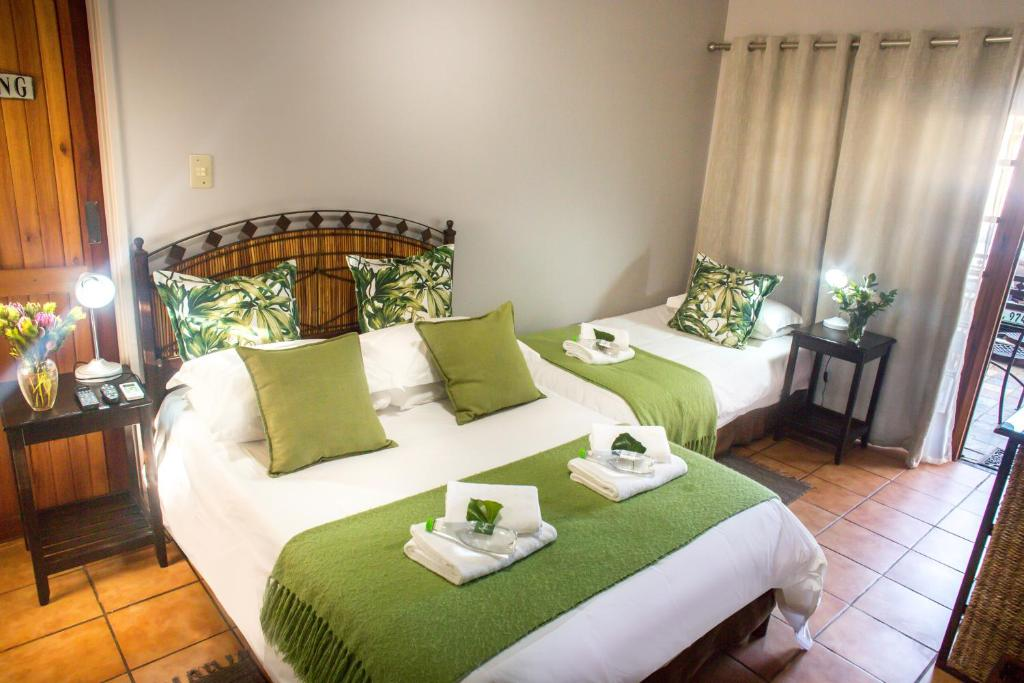 A bed or beds in a room at Amity Guesthouse