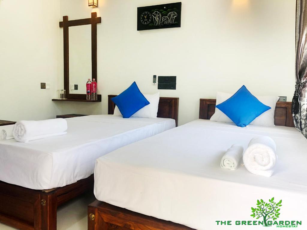 A bed or beds in a room at The Green Garden
