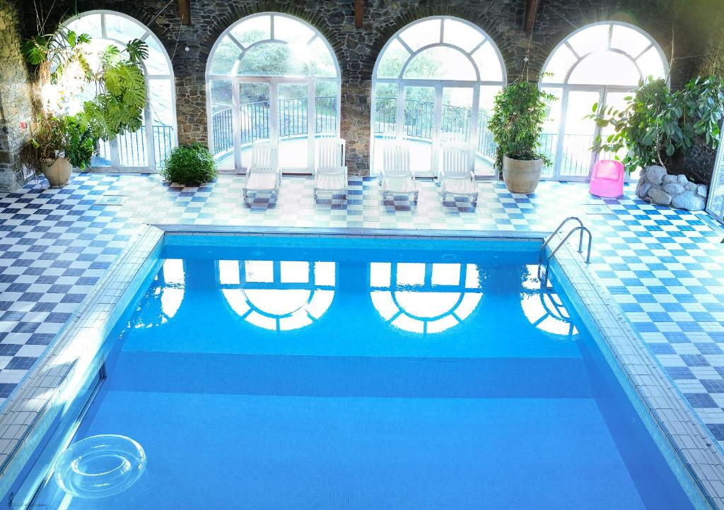 The swimming pool at or near Hotel Spa Llop Gris