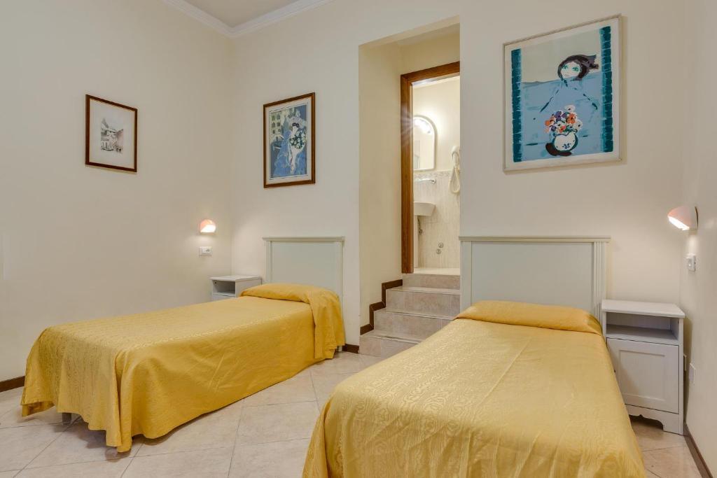 Un ou plusieurs lits dans un hébergement de l'établissement Hotel Universo & Nord