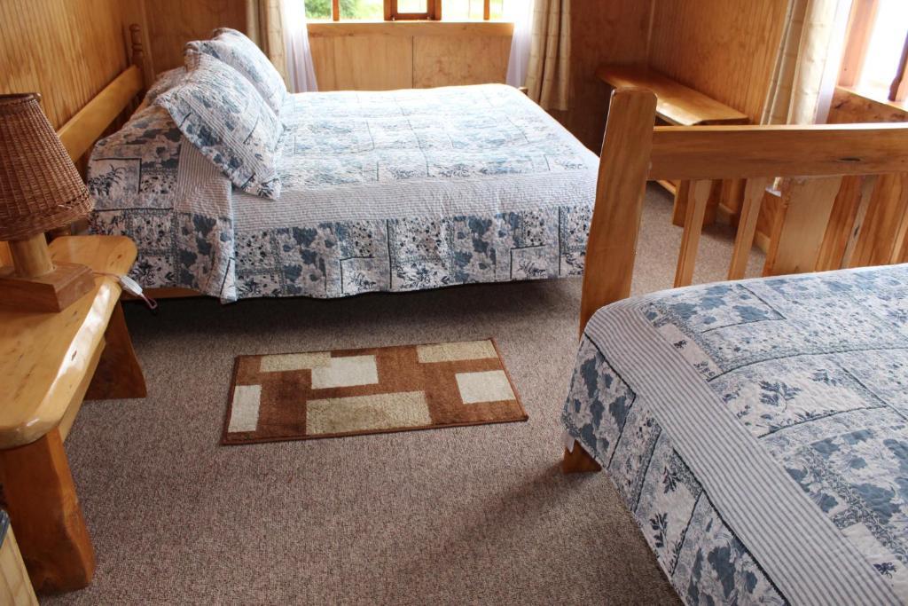 Los Mañíos Del Queulat tesisinde bir odada yatak veya yataklar