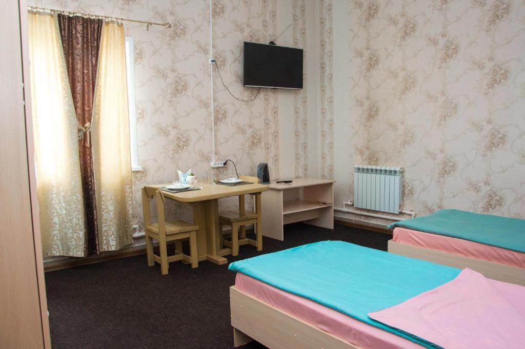 """Кровать или кровати в номере Гостиница """"Арарат"""""""