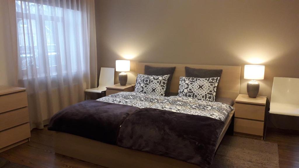 Gulta vai gultas numurā naktsmītnē Bright and cosy apartment in Riga
