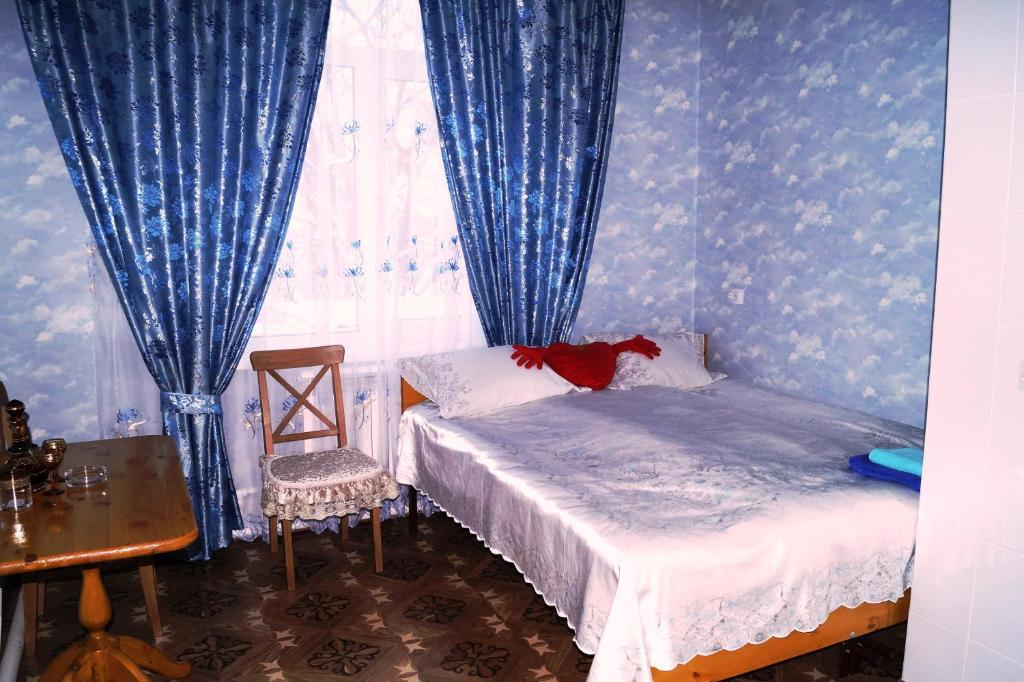 Кровать или кровати в номере Guest House on Lenina 70