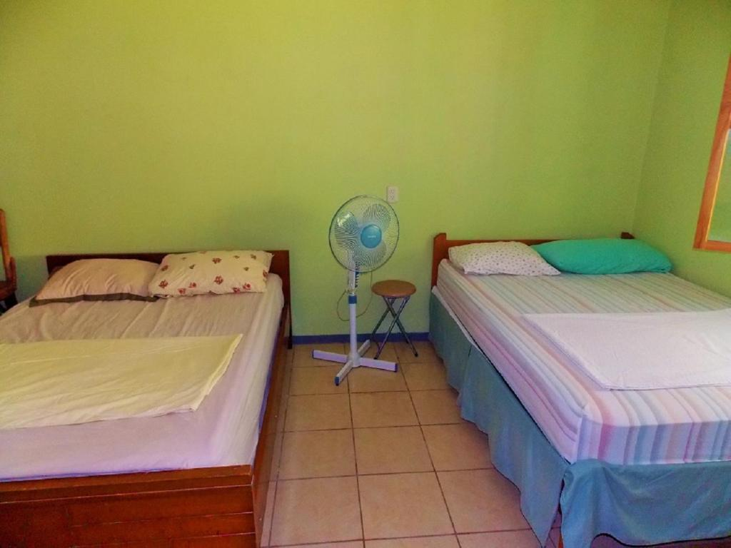 A bed or beds in a room at Casa ISLA BONITA