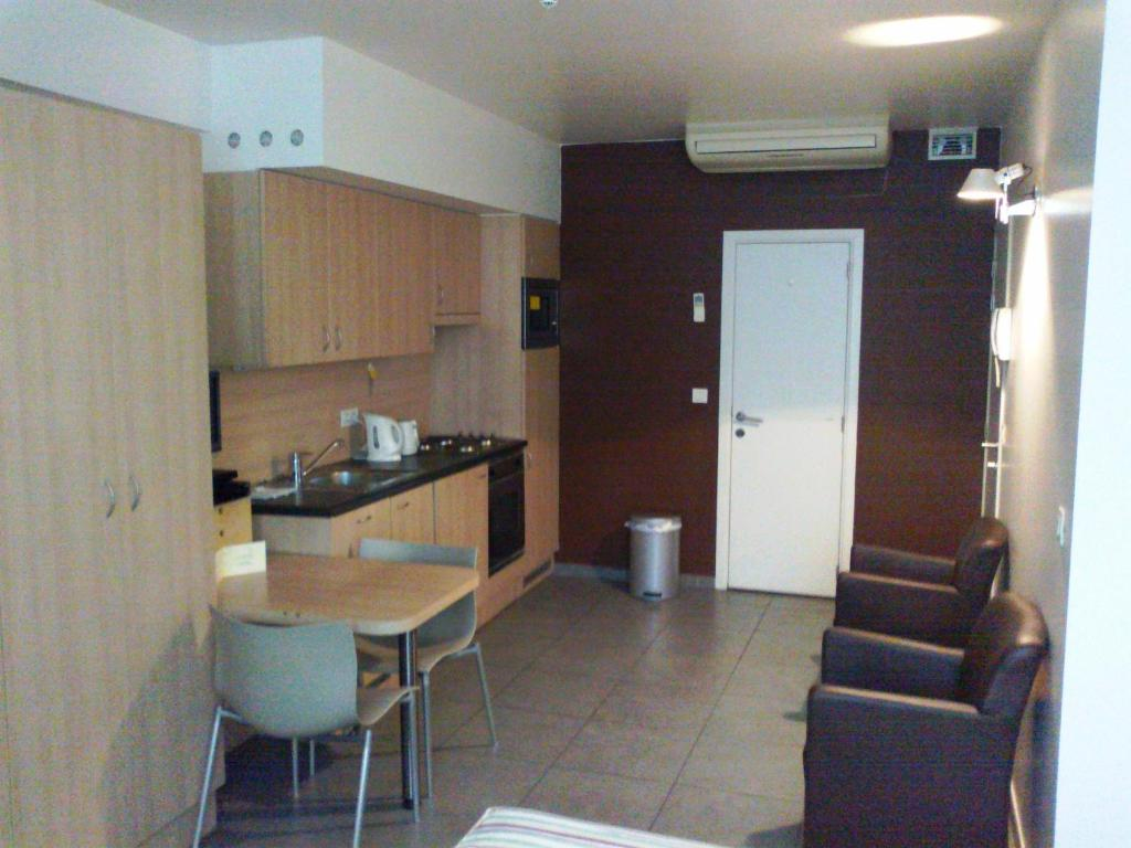 A kitchen or kitchenette at Apartments Downtown Residence Brussels