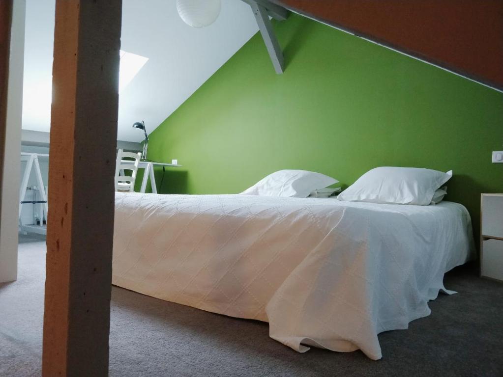 Voodi või voodid majutusasutuse Etage privatif toas