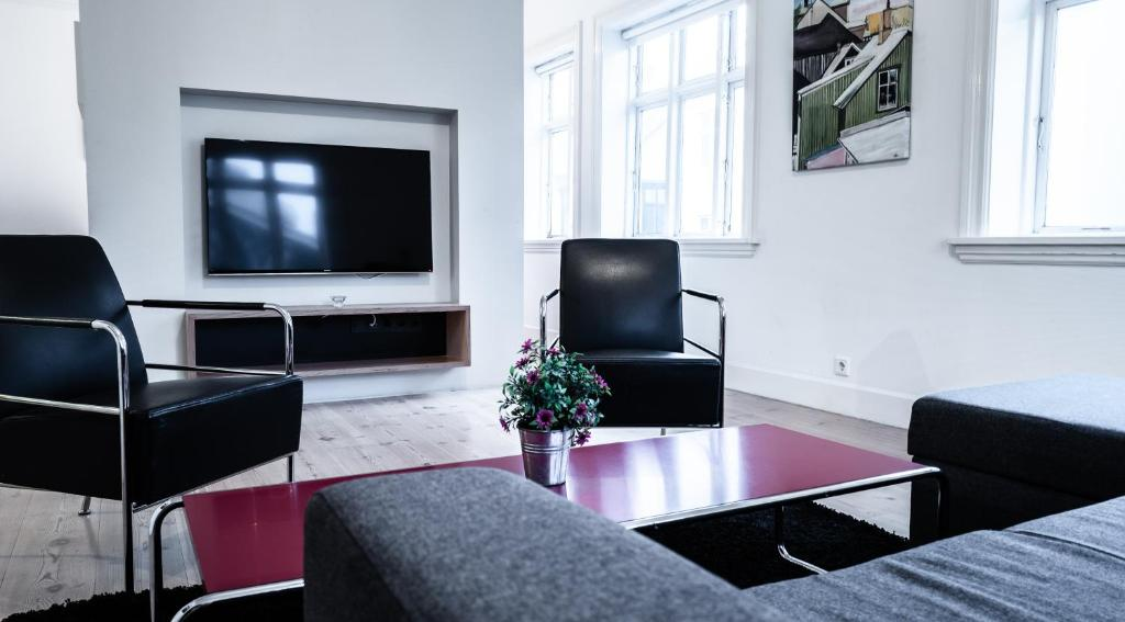 A television and/or entertainment center at Luna Apartments - Laugavegur 37
