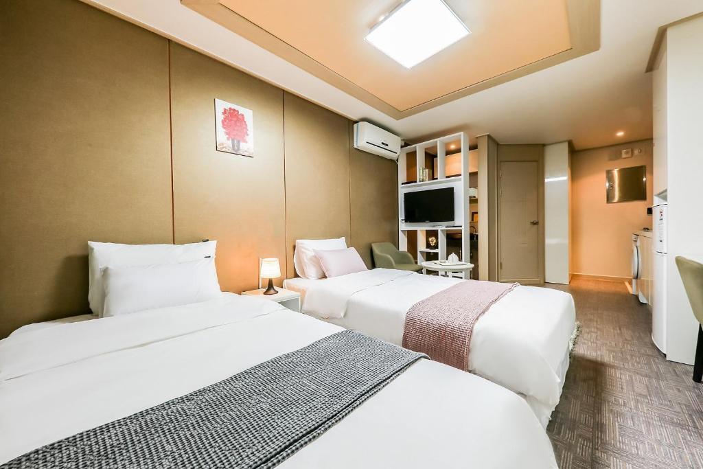 레지던스 호텔 라인 객실 침대