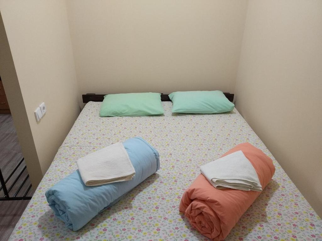 A bed or beds in a room at Hostel Dom