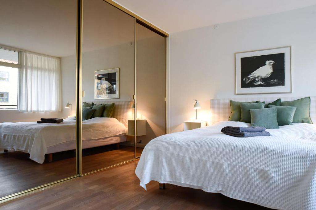 A bed or beds in a room at Borgergade