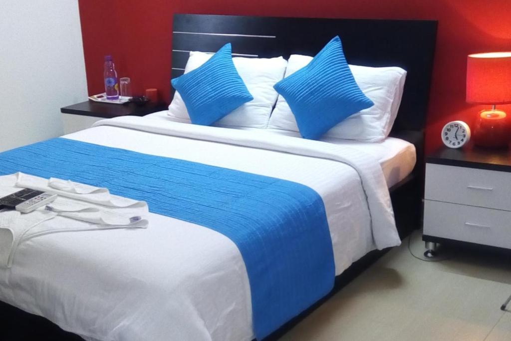 A Bed Or Beds In Room At The Premium Chennai