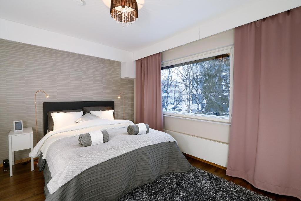 A bed or beds in a room at Central Riverside Apartment