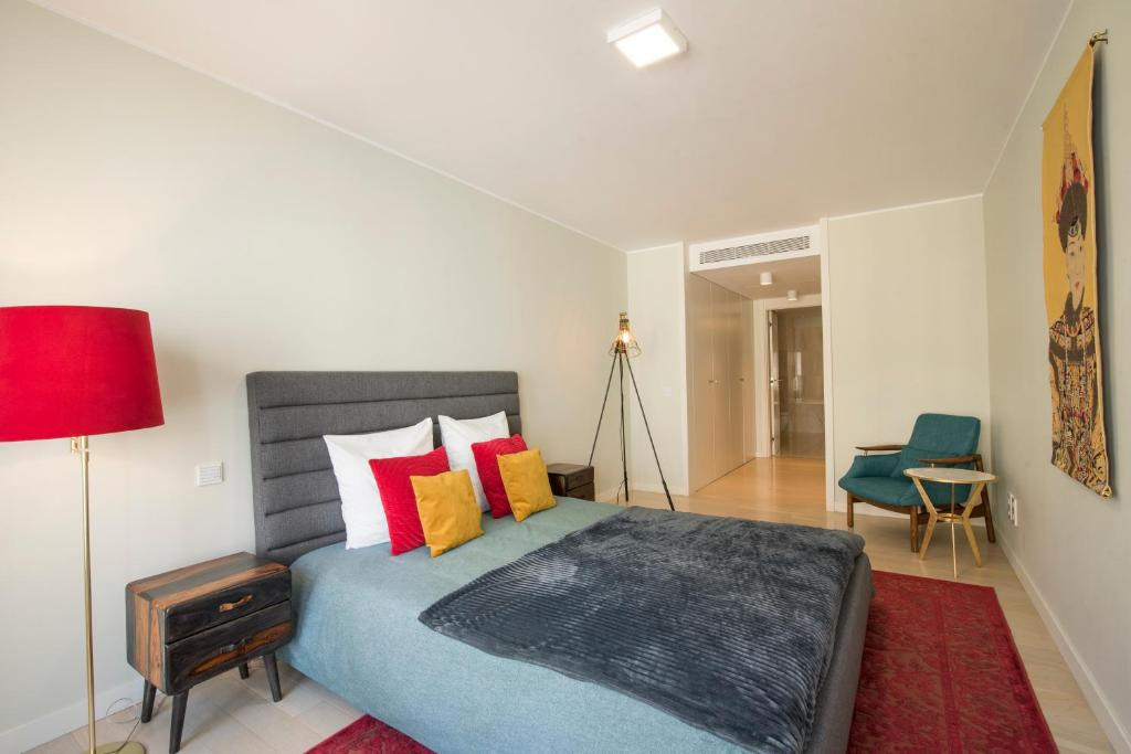 A bed or beds in a room at Luxurious Liberdade - Lisbon Heart