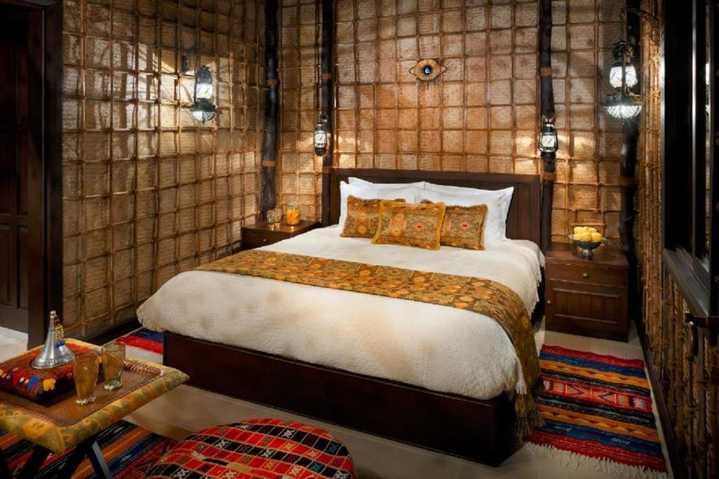 A bed or beds in a room at Arabian Nights Village