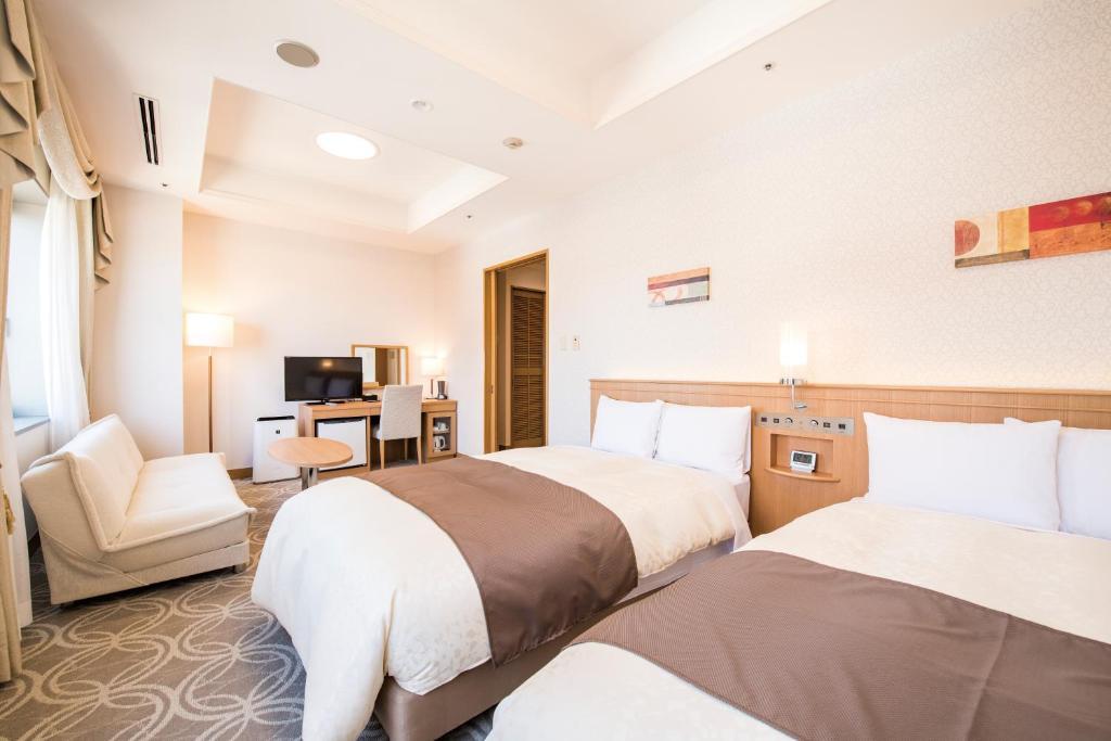 Кровать или кровати в номере Hotel Port Plaza Chiba