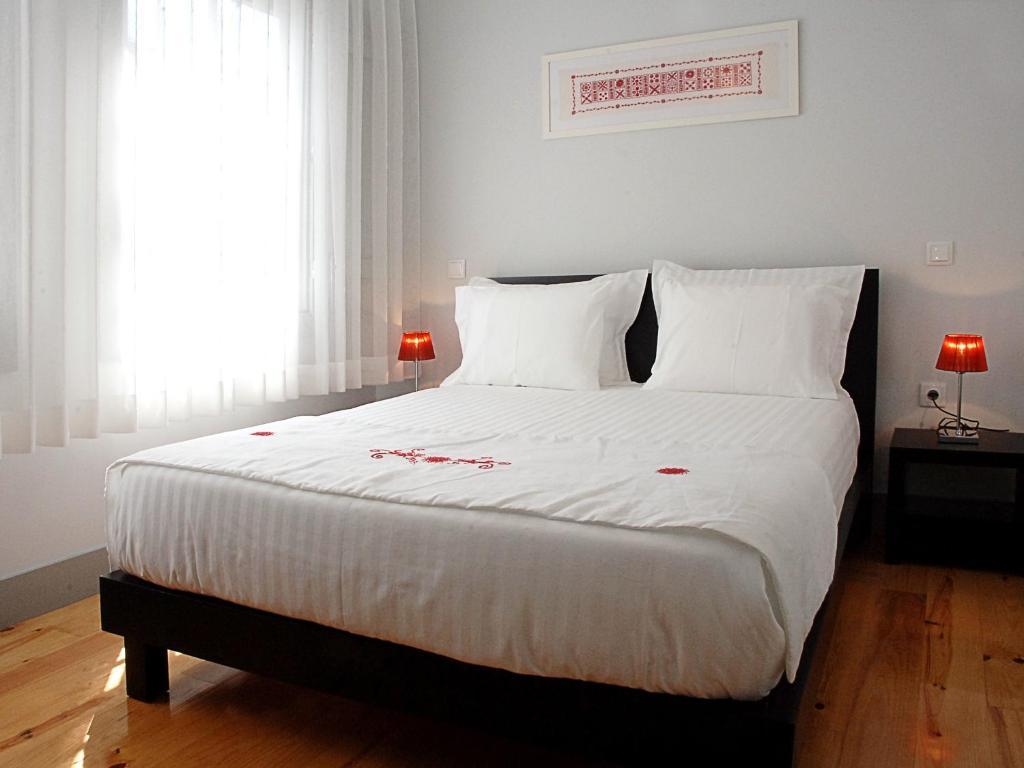 Ein Bett oder Betten in einem Zimmer der Unterkunft Guest House Vimaranes