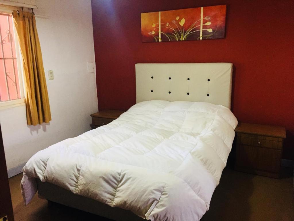 Casa en Fisherton 객실 침대