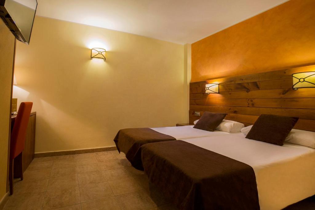 Een bed of bedden in een kamer bij Magic Pas