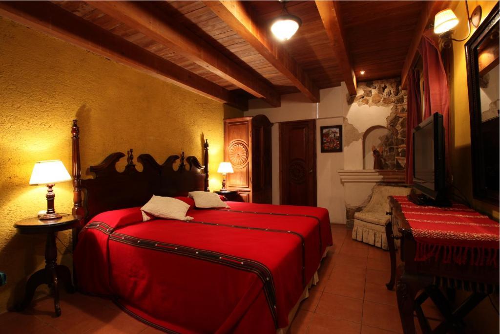Cama o camas de una habitación en Hotel Candelaria Antigua