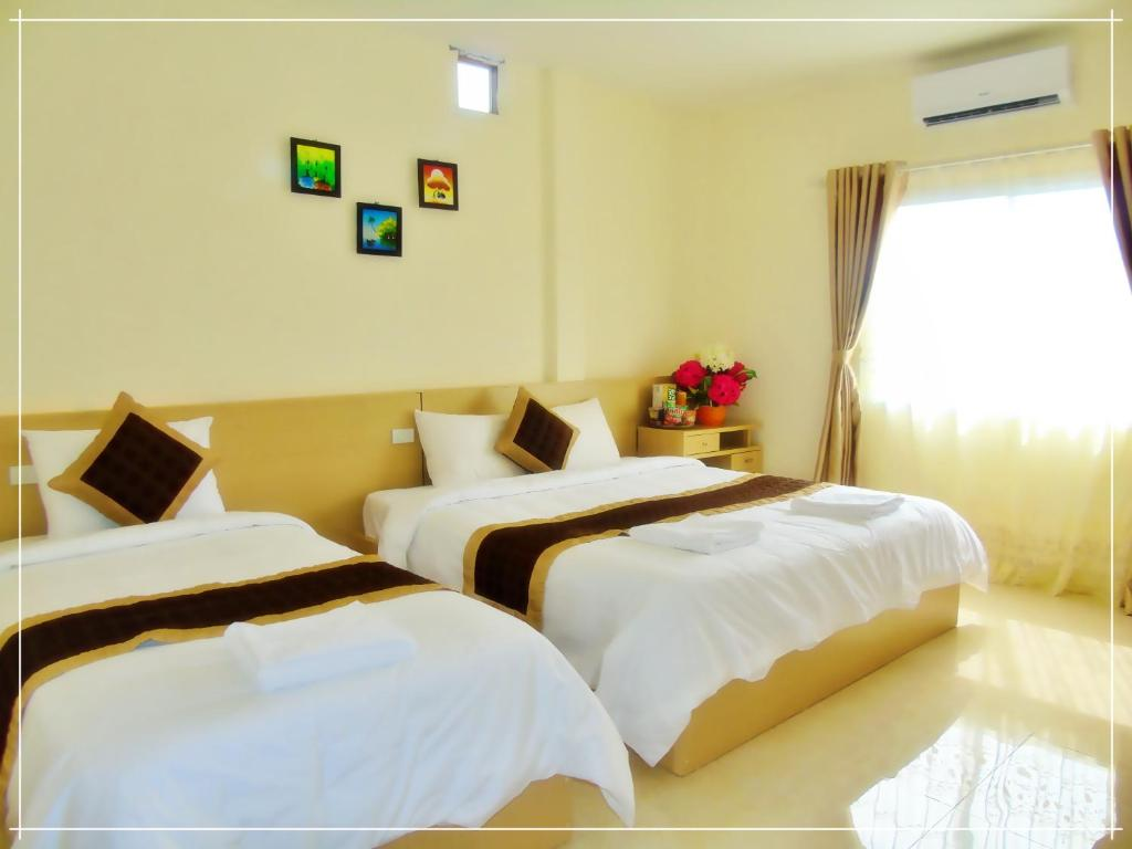 A bed or beds in a room at Vang Vieng Galaxy Guesthouse