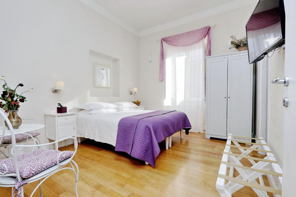 A bed or beds in a room at Guest House Amaranto Romano