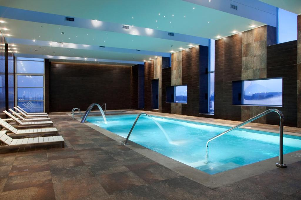 The swimming pool at or near Hilton Garden Inn Santiago Airport