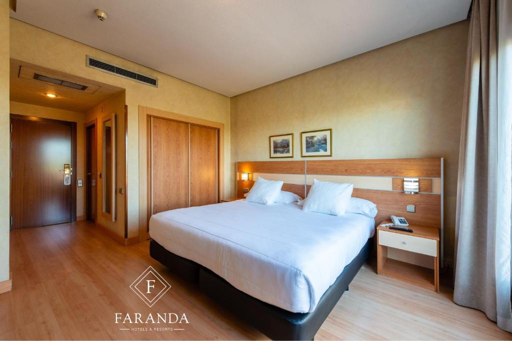 Llit o llits en una habitació de City House Hotel Florida Norte By Faranda