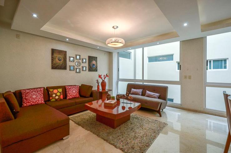 A seating area at Coyoacan Florida Luxury apartment 4BR-4BA 2Parking