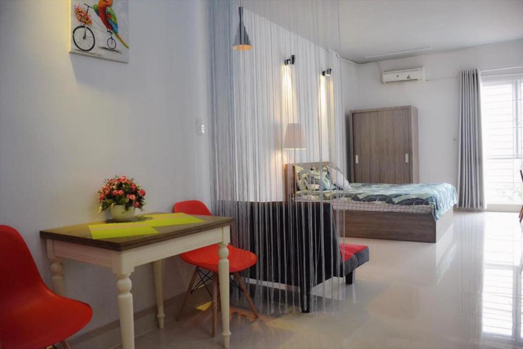 Гостиная зона в Mon house 3 - 169/6A Vo Thi Sau Stress, D.3, HCMC