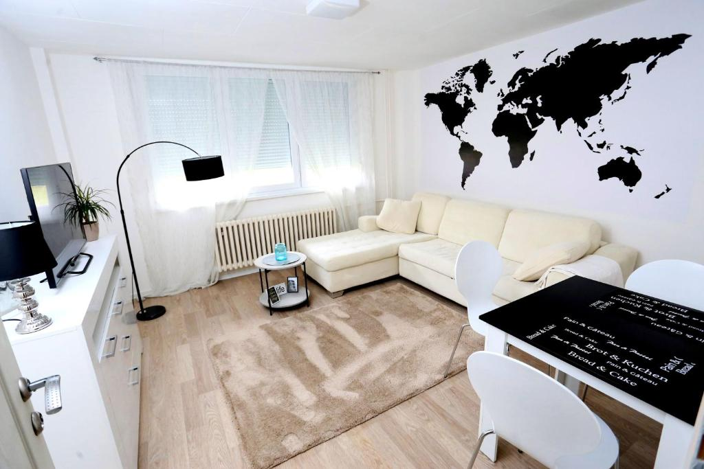 A seating area at Apartman City Lux