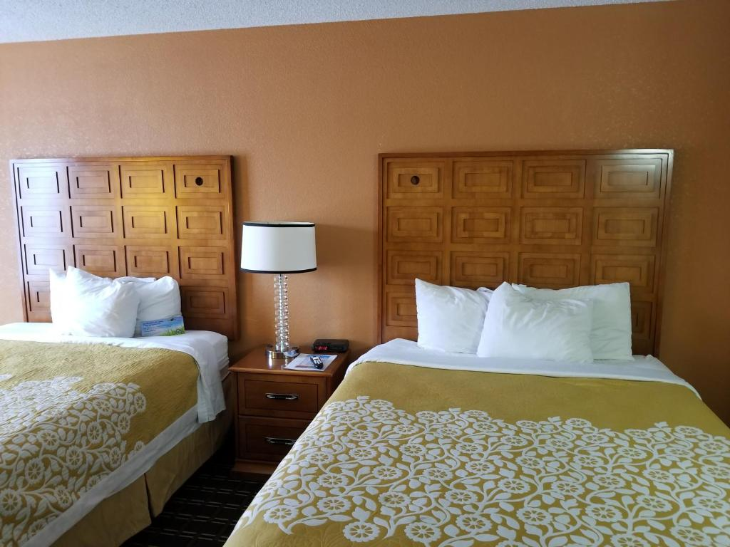 A Bed Or Beds In Room At Days Inn By Wyndham Black River Falls