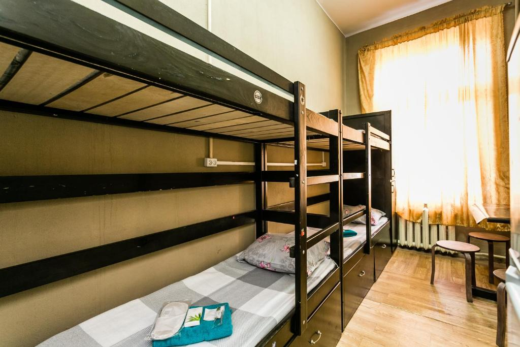 A bunk bed or bunk beds in a room at Hostel Dominus