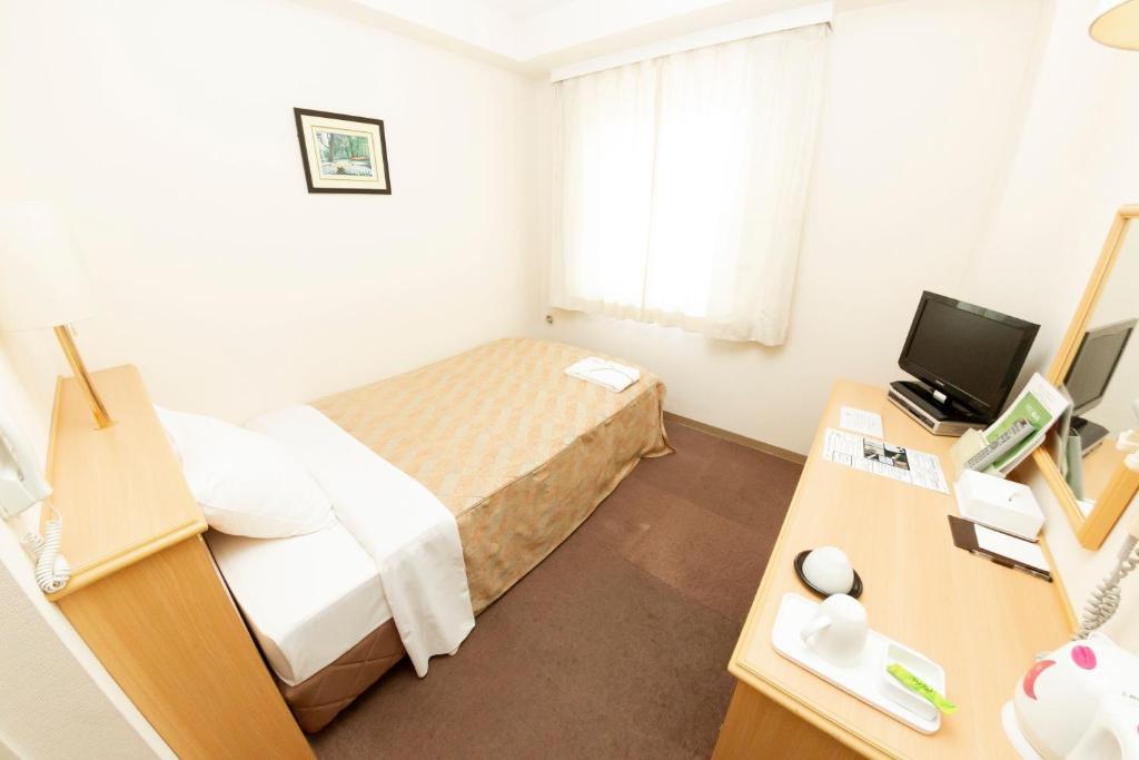 ポイント2.シングルルームに2人泊まれる!広々客室