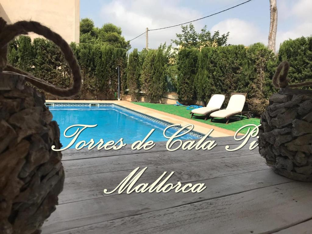 The swimming pool at or near Torres de Cala Pi