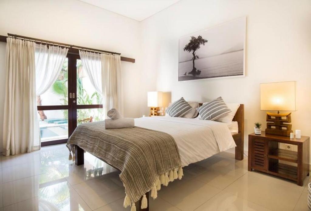 Voodi või voodid majutusasutuse Evelina toas