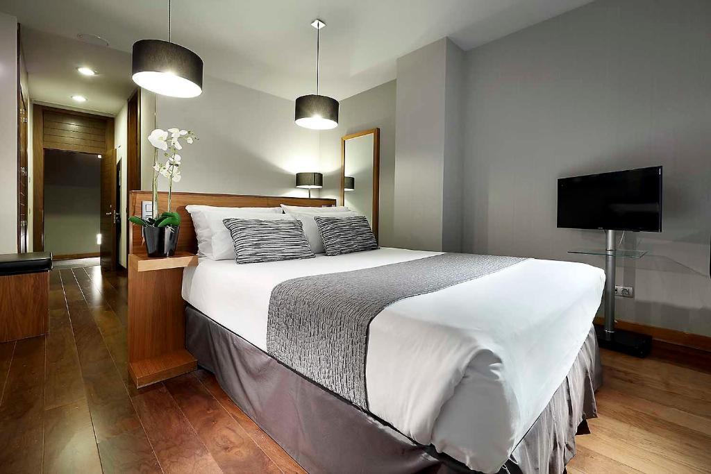 A bed or beds in a room at Eurostars Madrid Congress