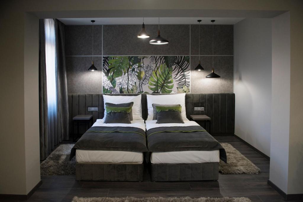 Cama o camas de una habitación en Hotel Central